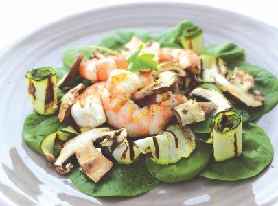 Scampi met spinazie en bruine champignons